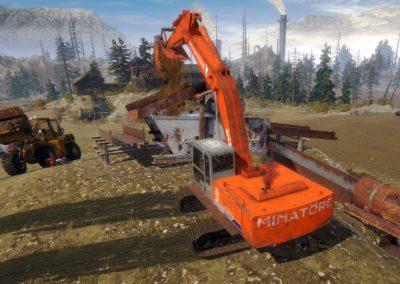 Excavator Inserts Dirt to Washplant Trommel